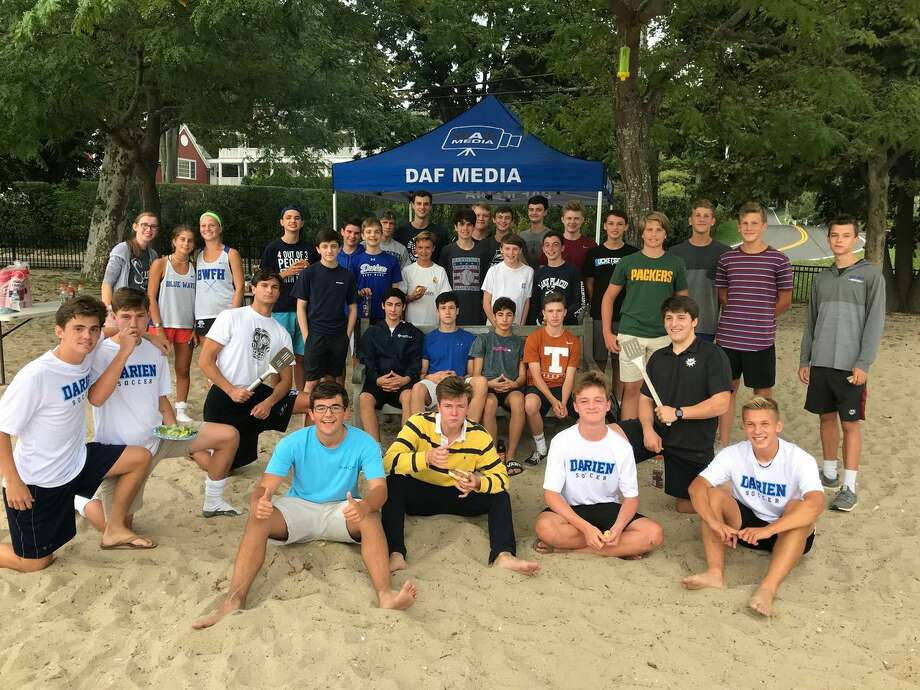 DAF Media gathered at their back-to-school barbecue at Pear Tree Point Beach last fall.  There are 49 students, between grades 9-12, involved with DAF Media. The organization produces an average of 120 live events per year for their YouTube channel. Photo: Darien Athletic Foundation