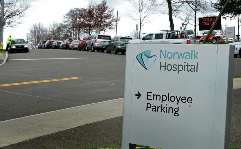 People wait inline for coronavirus testing at Norwalk Hospital Wednesday, April 8, 2020, in Norwalk, Conn. Photo: Erik Trautmann / Hearst Connecticut Media / Norwalk Hour