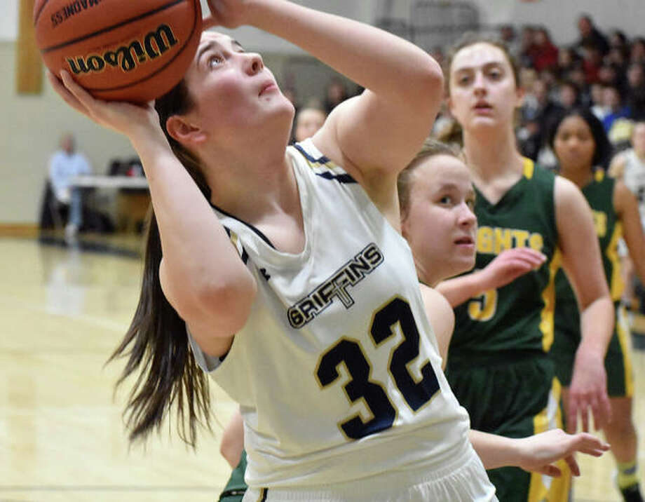 FMCHS senior center Madison Webb scores two of her career-high 28 points in a regional championship win over Metro-East Lutheran in Edwardsville. Photo: Matt Kamp|The Intelligencer