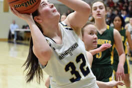FMCHS senior center Madison Webb scores two of her career-high 28 points in a regional championship win over Metro-East Lutheran in Edwardsville.