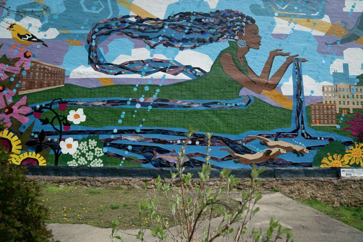 The Philadelphia Water Department helped with the makeover of this neighborhood park, which now includes a rain garden and a water related mural.