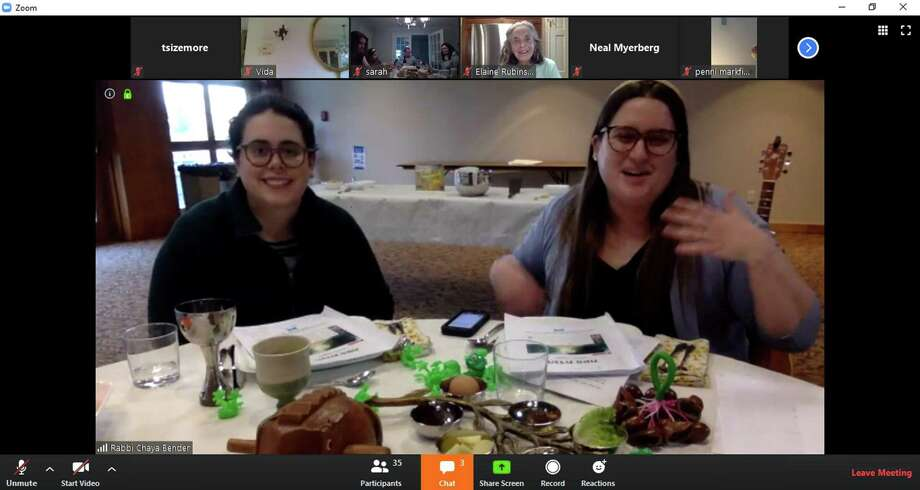 Rabbi Chaya Bender, right, accompanied by her wife, Emily Jaeger, lead the Temple Sholom seder on a Zoom meeting attended by many other Temple Sholom congregants. Celebrating the start of Passover, the seder dinner featured interactive questions, singalongs, and seder-themed hats. More than 50 families attended the online meetup, allowing for a sense of community and togetherness in a time of social distancing and isolation. Photo: Contributed Photo / Contributed Photo / Contributed Photo