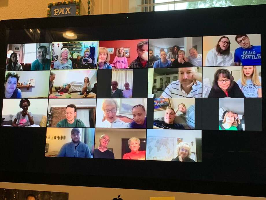 A screen shot shows the McMorran family on one of their recent Zoom calls. The virtual gatherings include more than 30 people in four countries on four continents. Photo: McMorran Family / Contributed Photo