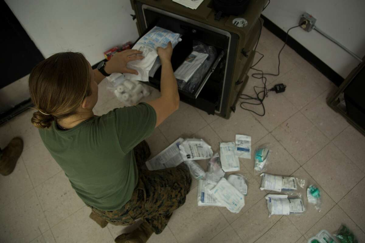 200405-M-RB959-1031 NAVAL BASE GUAM (April 5, 2020) Lt. j.g. Caroline Kivisto, an emergency room nurse with 3rd Medical Battalion, 3rd Marine Logistics Group, prepares an airway cart as part of creating an operationally capable intensive care unit, in order to provide medical support to any Sailors assigned to the aircraft carrier USS Theodore Roosevelt (CVN 71) in need, at Naval Base Guam, April 5, 2020. As the nation�s force-in-readiness, the military has a variety of capabilities which, upon request, may be used to support the whole-of-government effort in response to the COVID-19 pandemic. (U.S. Marine Corps photo by Staff Sgt. Jordan E. Gilbert/Released)