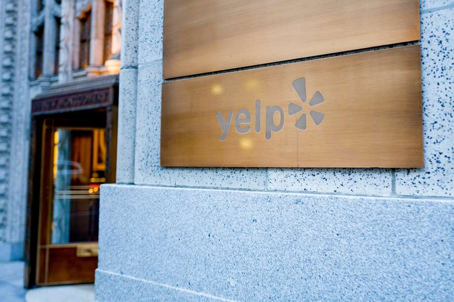 Close-up of the sign at the headquarters of travel and restaurant rating company Yelp in San Francisco in December 2018. Photo: Smith Collection/Gado/Getty Images