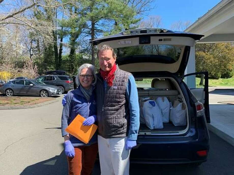 P2P board member Pam Dysenchuck and her husband David, prepare to deliver food to at-risk P2P clients. Photo: Person-to-Person