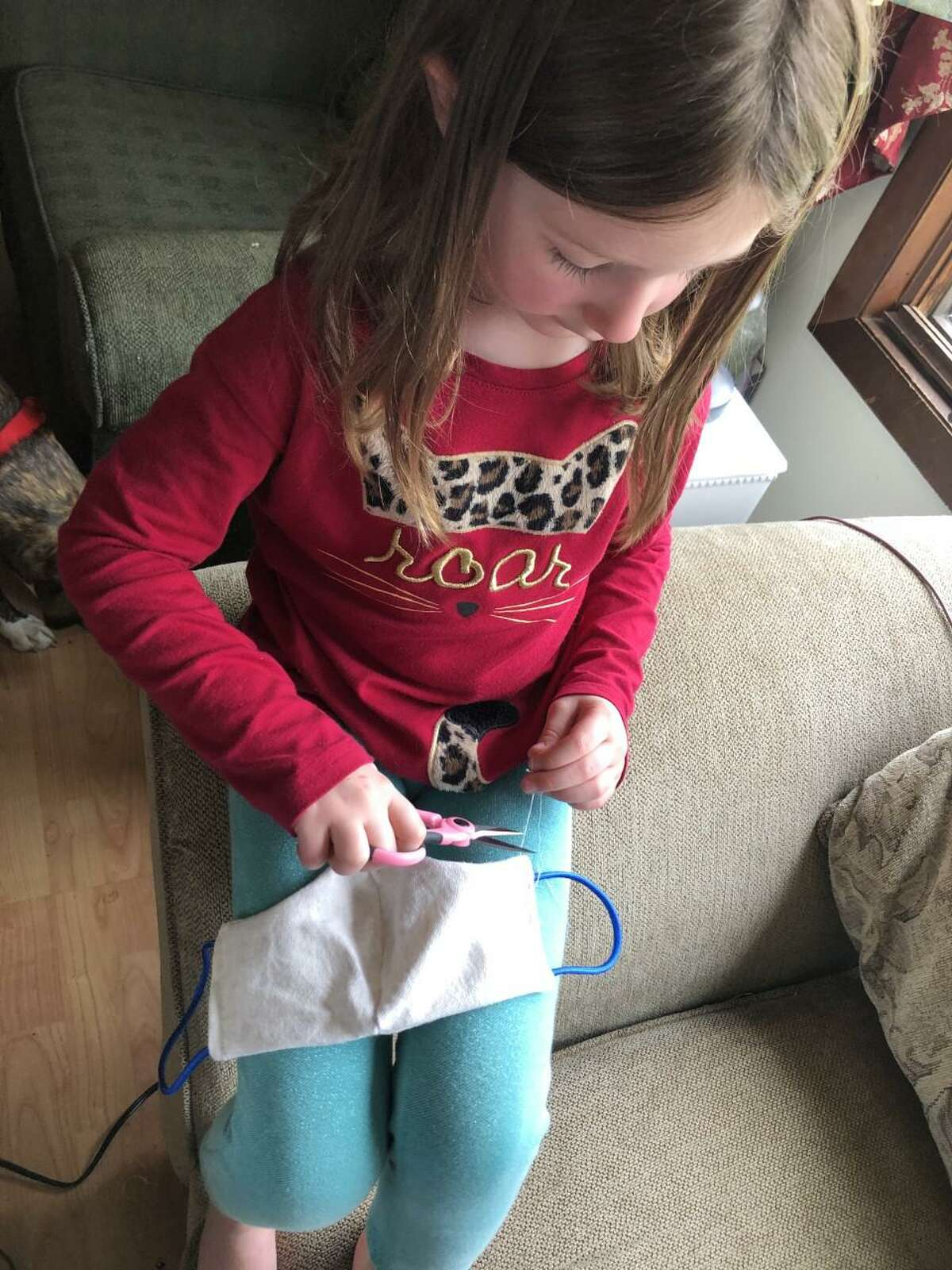 """""""We are always talking about kindness in our schools and the capacity of the human heart, said Trumbull resident Abbie Smith. She and her children are making and giving away masks for free to those in Trumbull.""""This is our opportunity to give to our neighbors what we know how."""""""