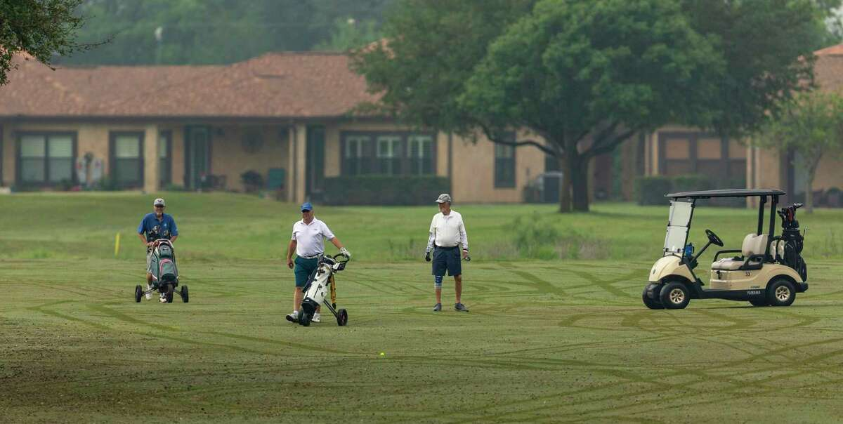 Golfers play Wednesday at the Alsatian Golf Club outside Castroville in Medina County. Only a few courses remained open within driving distance of San Antonio, which closed its courses last week. But local officials were under pressure from Gov. Greg Abbott to close them until he offered a compromise Thursday.