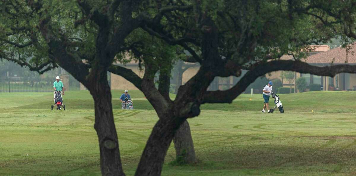 Golfers play at the Alsatian Golf Club outside Castroville in Medina County.