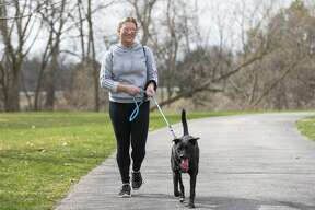 Lidsey Dice and her dog Gotti enjoy the weather on the Rail Trail Wednesday, April 8, 2020. (Adam Ferman/for the Daily News)