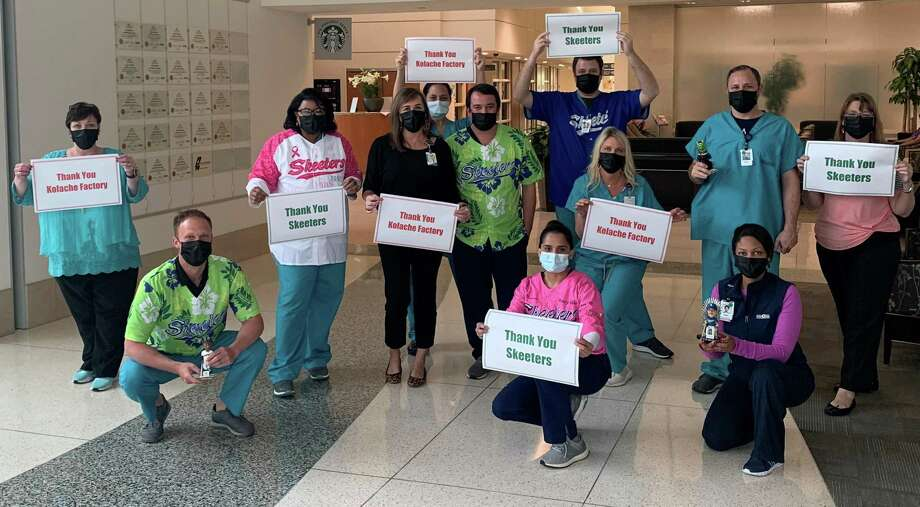 A group of medical workers at Memorial Hermann Sugar Land Hospital responds in gratitude on Tuesday, April 7, after the Sugar Land Skeeters and Kolache Factory bring them 500 kolaches for daily serving on the front lines of the COVID-19 pandemic. Photo: Courtesy Of Memorial Hermann