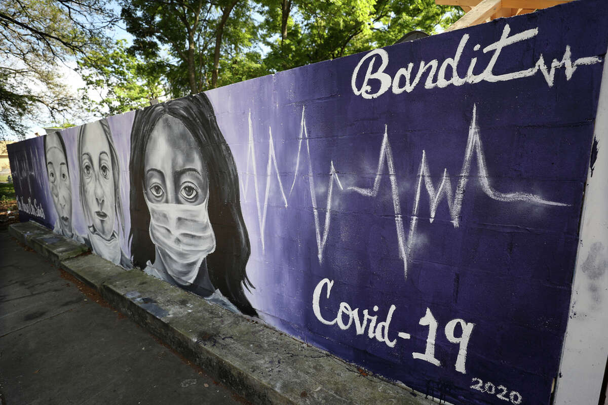 A painting by the graffiti artist Bandit titled Our Nurses, Our Saints is seen on a wall in the lower ninth ward on April 03, 2020 in New Orleans, La.