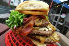 The Jack Burton Burger at Papa's Burgers weighs in at a pound with triple meat, bacon, cheese and the trimmings.