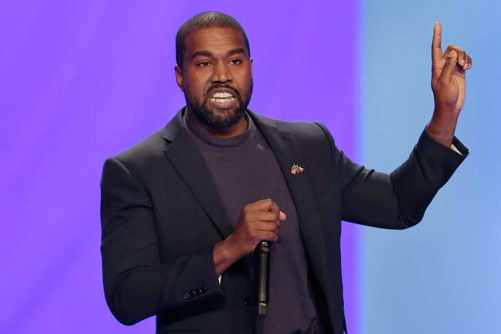 In this Nov. 17, 2019 file photo Kanye West answers questions from Sr. pastor Joel Osteen during a service at Lakewood Church in Houston.