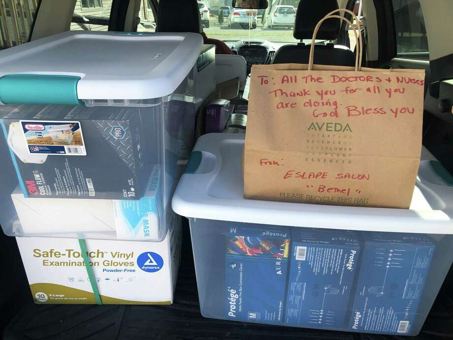 Escape Salon in Bethel is creating care packages and collecting supplies to give to Danbury Hospital and local first responders. Photo: Contributed Photo / Contributed / The News-Times Contributed