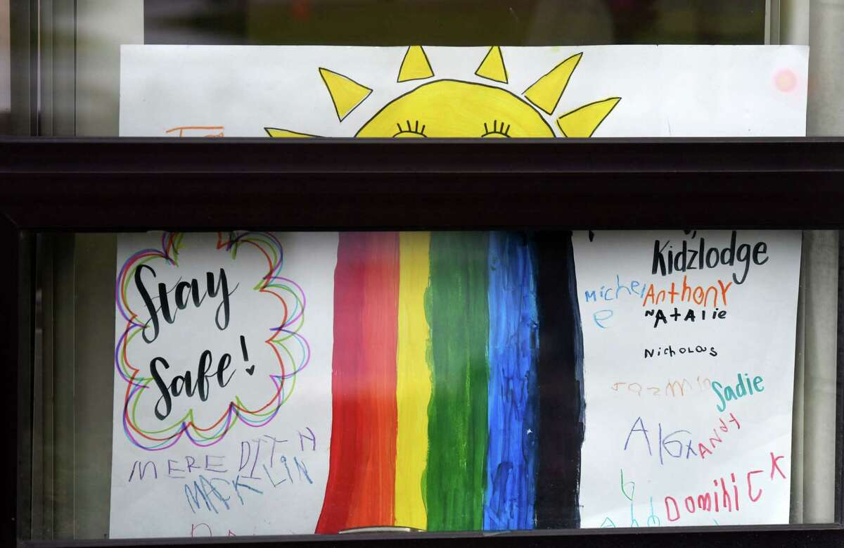 A message of hope is displayed in a window at the YMCA KidzLodge Early Learning Center on Thursday, April 9, 2020, in Clifton Park, N.Y. (Will Waldron/Times Union)