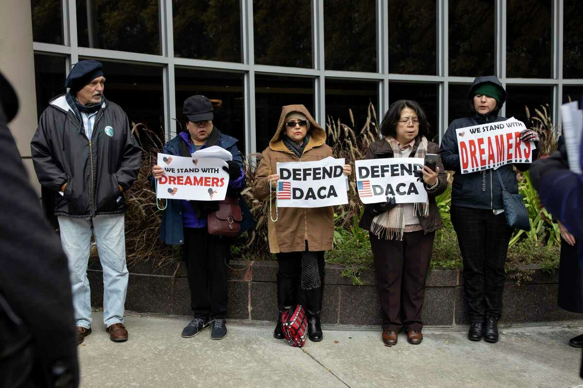In this November 2019 file photo, DACA advocates host a vigil in front of Bob Casey Federal Courthouse in Houston to express their support for the program.