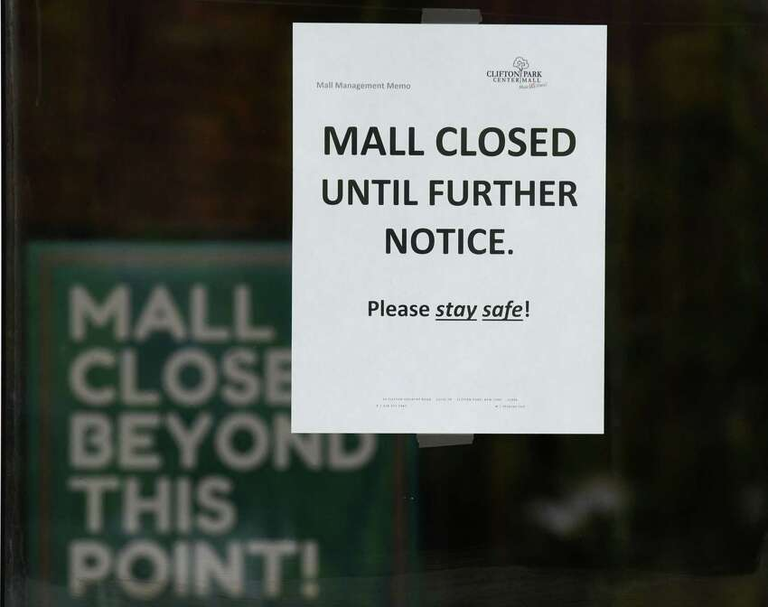 A closed sign is posted the Clifton Park Center shopping mall during the coronavirus lockdown on Thursday, April 9, 2020, in Clifton Park, N.Y. New York's jobless claims over the past three weeks now nearing 800,000. (Will Waldron/Times Union)