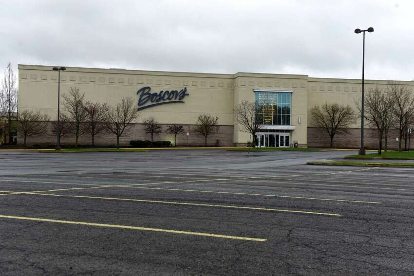 An empty parking lot is seen outside the Boscov's department store at Clifton Park Center shopping mall during the coronavirus lockdown on Thursday, April 9, 2020, in Clifton Park, N.Y. New York's jobless claims over the past three weeks now nearing 800,000. (Will Waldron/Times Union)