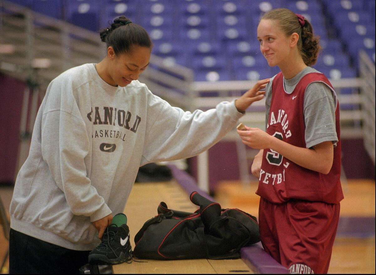 Stanford's Naomi Mulitauaopele, left, and Kate Starbird share a light moment before practice at the University of Washington in Seattle Friday, March 22, 1996, where they will face Alabama in the NCAA western regional Saturday night. (AP Photo/Robert Sorbo)
