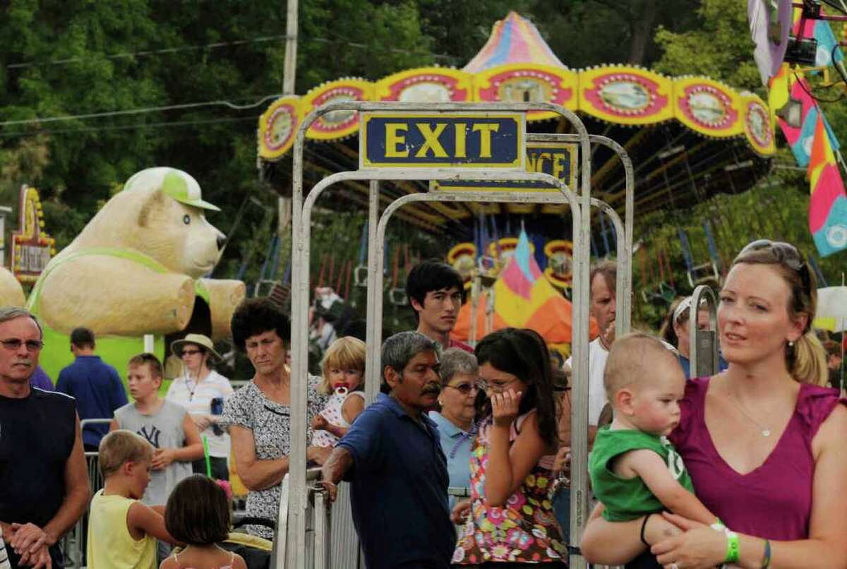 Riders make their way through the bustling midway at the Altamont Fair. ( Michael P. Farrell / Times Union )