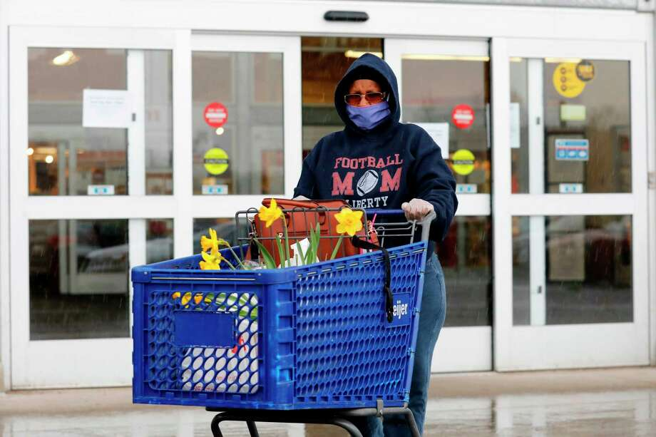 TheCenters for Disease Control and Prevention and theMichigan Department of Health and Human Services recommends thatpeoplewear a face covering when outside of their home, such as shopping for essentials, to help stop the spread of the coronavirus.(Photo by JEFF KOWALSKY/AFP via Getty Images) / AFP