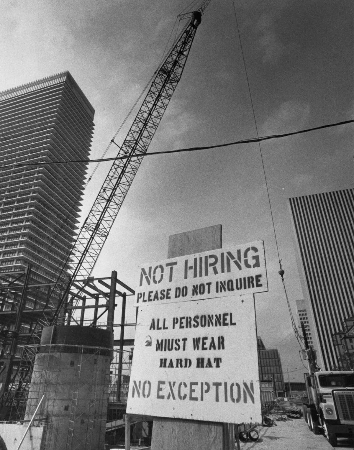 July 22, 1982: A sign discourages job-seekers at a downtown construction site during the economic downturn of the 1980s.