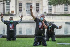 Pastor Eloy Tamez (center) lead a prayer before Mayor Sylvester Turner started an observe a Day of Prayer with elected officials and community leaders for a moment of collective prayer, silence and meditation on the grounds of City Hall Thursday, April 9, 2020, in Houston.