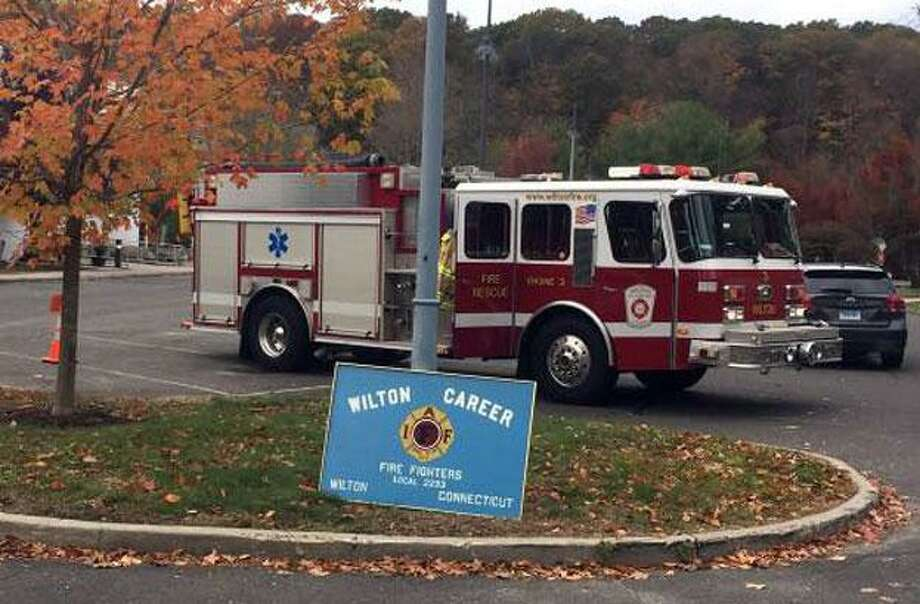 Members of the Wilton Fire Department are stories for children this via Zoom. Photo: Wilton Fire Department Photo