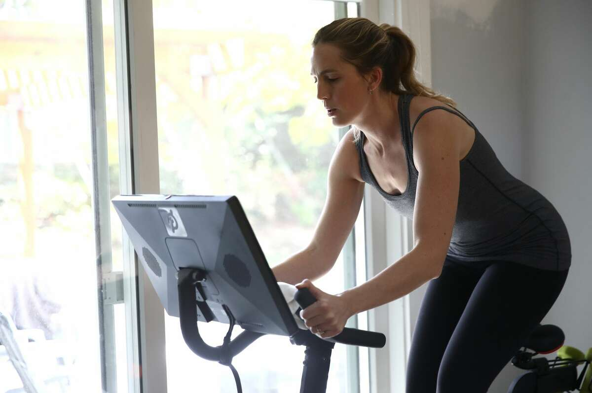 Jen Van Santvoord rides her Peloton exercise bike at her home on April 07, 2020 in San Anselmo, California. More people are turning to Peloton due shelter-in-place orders because of the coronavirus (COVID-19). The Peloton stock has continued to rise over recent weeks even as most of the stock market has plummeted.