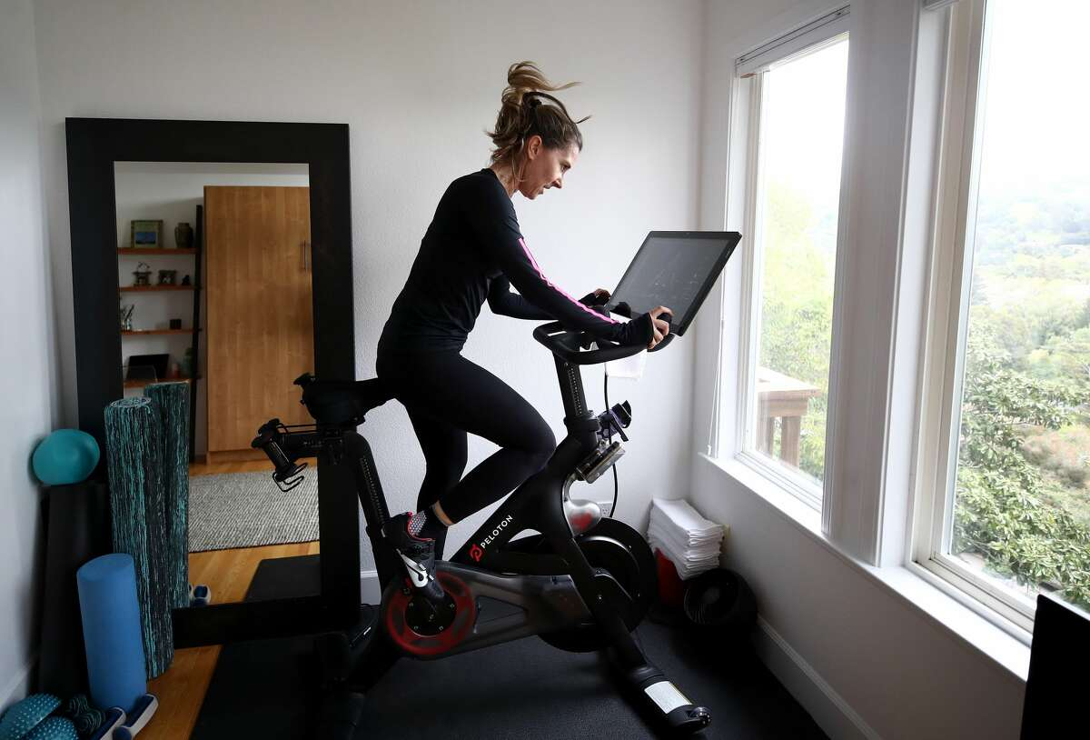 Cari Gundee rides her Peloton exercise bike at her home on April 06, 2020 in San Anselmo, California. More people are turning to Peloton due to shelter-in-place orders because of the coronavirus (COVID-19). Peloton stock has continued to rise over recent weeks even as most of the stock market has plummeted.