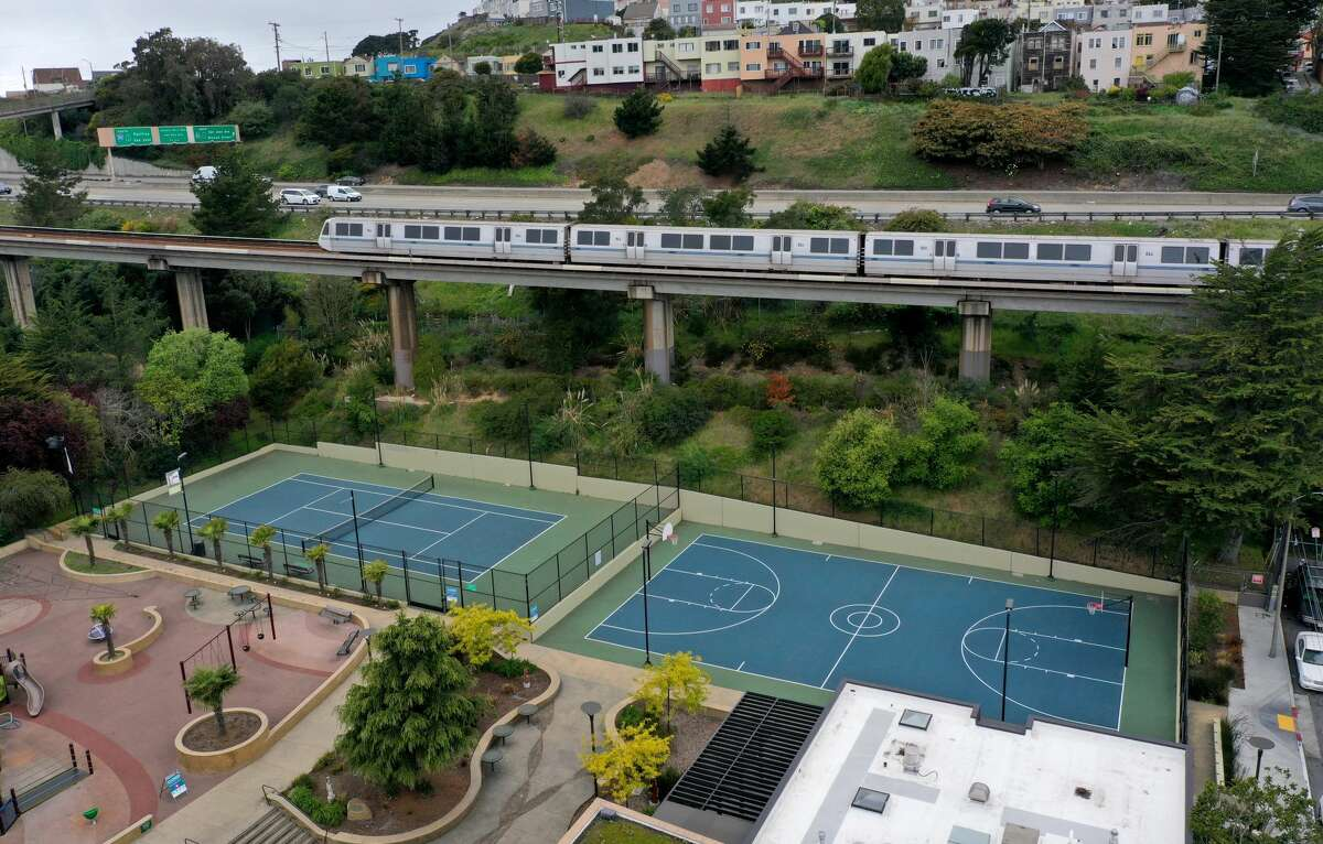 A BART train passes an empty playground on April 8, 2020 in San Francisco.
