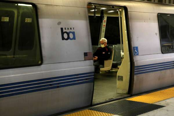 A Bay Area Rapid Transit (BART) passenger rides in an empty train car on April 08, 2020 in San Francisco, California. BART announced that it is slashing daily service as ridership falls dramatically due to the coronavirus shelter in place order. Starting Wednesday, regular Monday through Friday service will be reduced to running trains every half hour between 5 am and 9 pm.