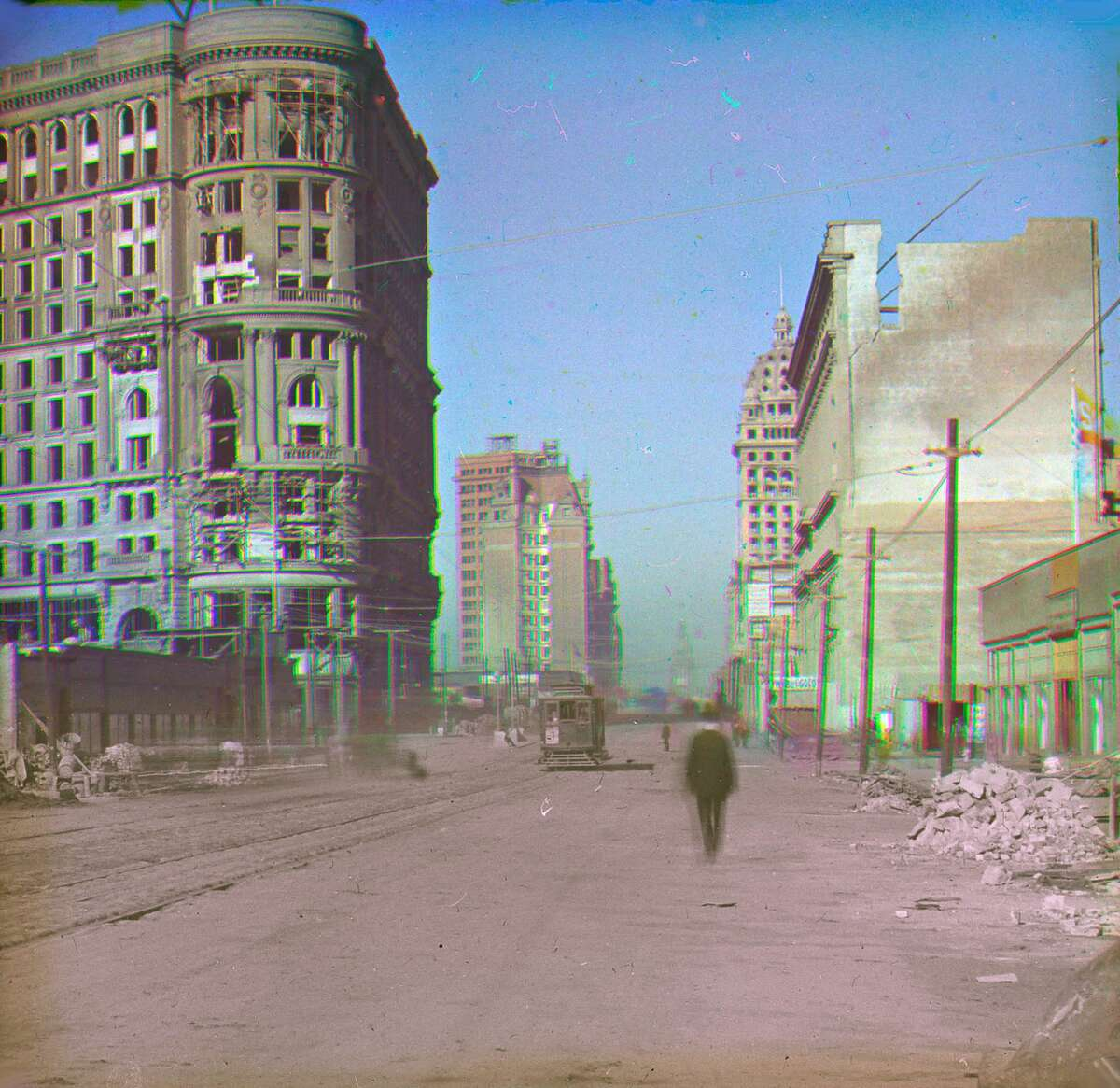 In this image by photo pioneer Frederick Ives, color illuminates scenes only ever before seen in black and white, and the effect of the quake and subsequent fire is clear. The shot shows a green street car on Market Street and the scarred walls of the Flood Building, which still stands at Powell and Market streets today.