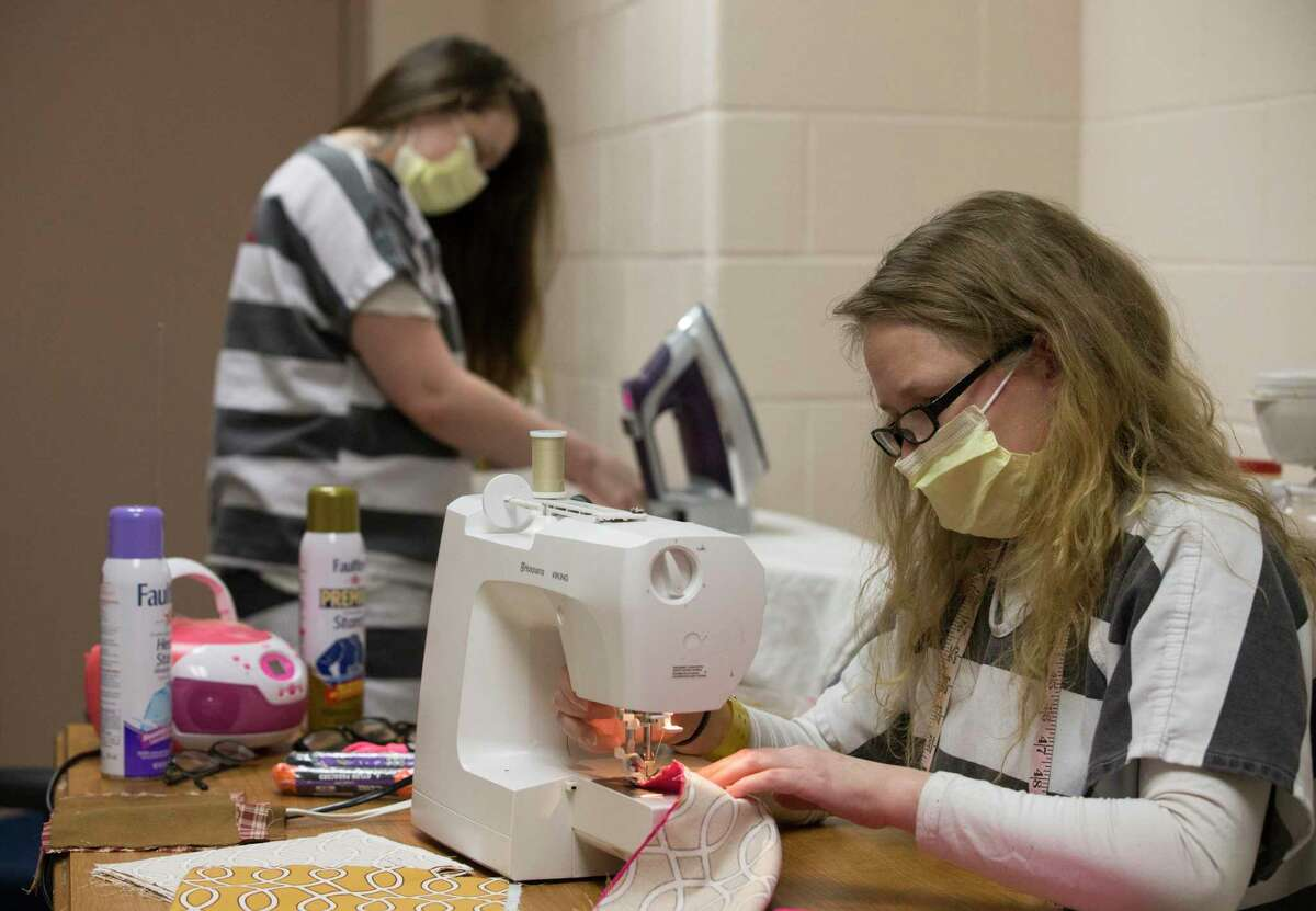 Fort Bend County Jail inmates Samantha Runke, left, and Andrea Pesce making cloth masks Thursday, April 9, 2020, in Richmond. The Fort Bend County Detention's sewing program started making face masks that will be distributed to all inmates and jail employees on April 6.