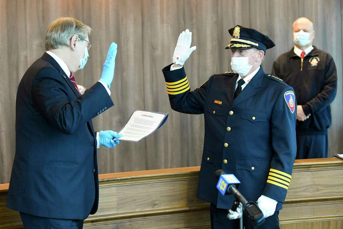 Former Easton Police Chief Tim Shaw is sworn in as Stamford's newest police chief by Mayor David Martin in a private ceremony at police headquarters on April 9, 2020 in Stamford, Connecticut. Shaw was joined by his family, wife Nancy, and his two children, daughter Taylor and son Ryan, along with a handful of officers and city officials in the community room.