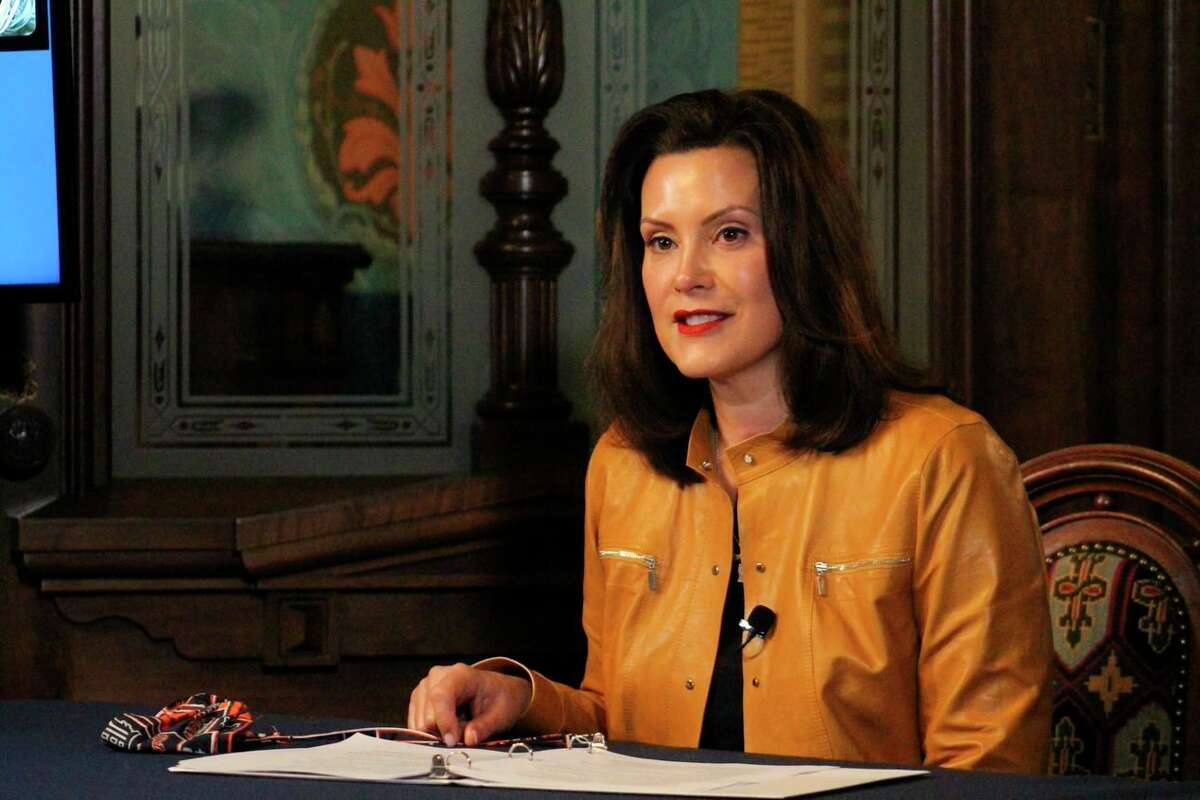 In this image provided by the Michigan Office of the Governor, Michigan Gov. Gretchen Whitmer addresses the state during a speech in Lansing, Mich., Monday, April 6, 2020.Thursday Whitmer extended the state's stay-at-home order through April 30.(Michigan Office of the Governor via AP)