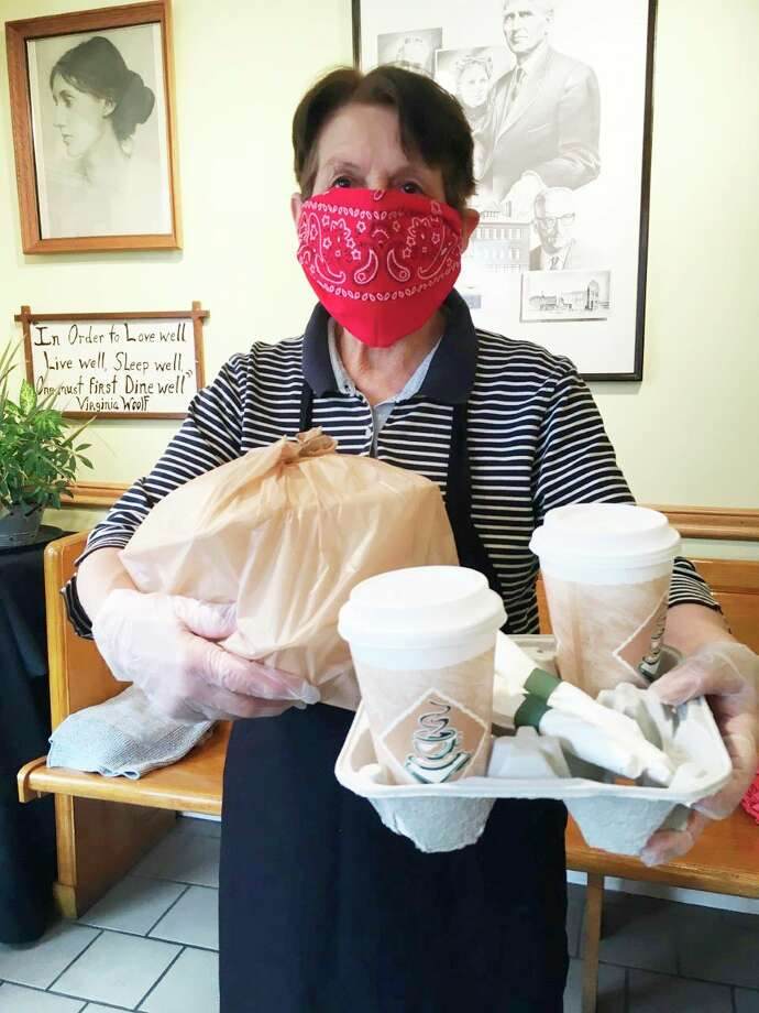Ala Mode employee Pamela Panek prepares to bring food outside to a customer. Restaurant employees are asking all employees to stay in their car when picking up food. (Courtesy photo)