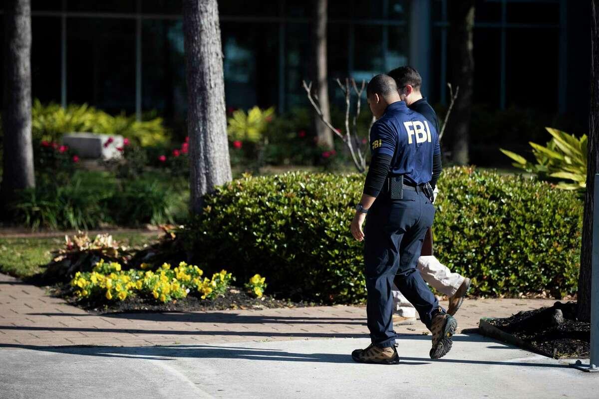 A man wearing an FBI shirt enters the Hattie Mae White, HISD Administration Building on Thursday, Feb. 27, 2020.