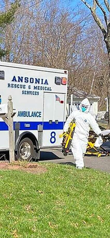 An official advised residents that Ansonia Rescue & Medical Services members will show up in full protective gear on calls where COVID-19 is suspected, and to not be alarmed. Photo: Contributed Photo /