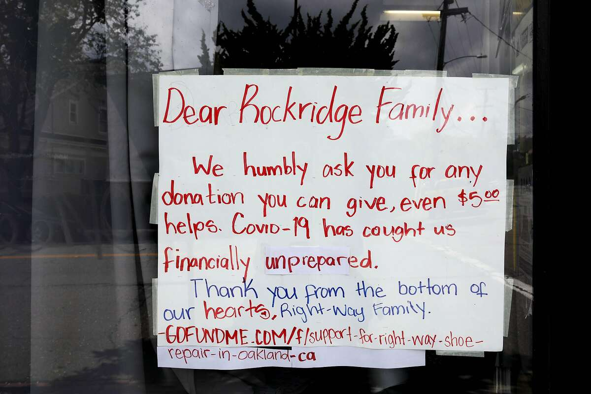 A sign is posted on a window at the Right Way Shoe Repair, located at 5479 College Ave., on Tuesday, April 7, 2020, in Oakland, Calif. The shop's owner, Gerardo Pena, can't pay this month's $2,700 in rent for the College Avenue location, a shop he's owned for 16 years. Same with the $2,300 he owes for Shoe Clinic on Piedmont Avenue. But this isn't about a business struggling to survive. This is about generations of families, particularly low-income and immigrant families, being impacted by the coronavirus. Pena has $500 in his bank. That's for food, his daughter, Leslie Pena, said.