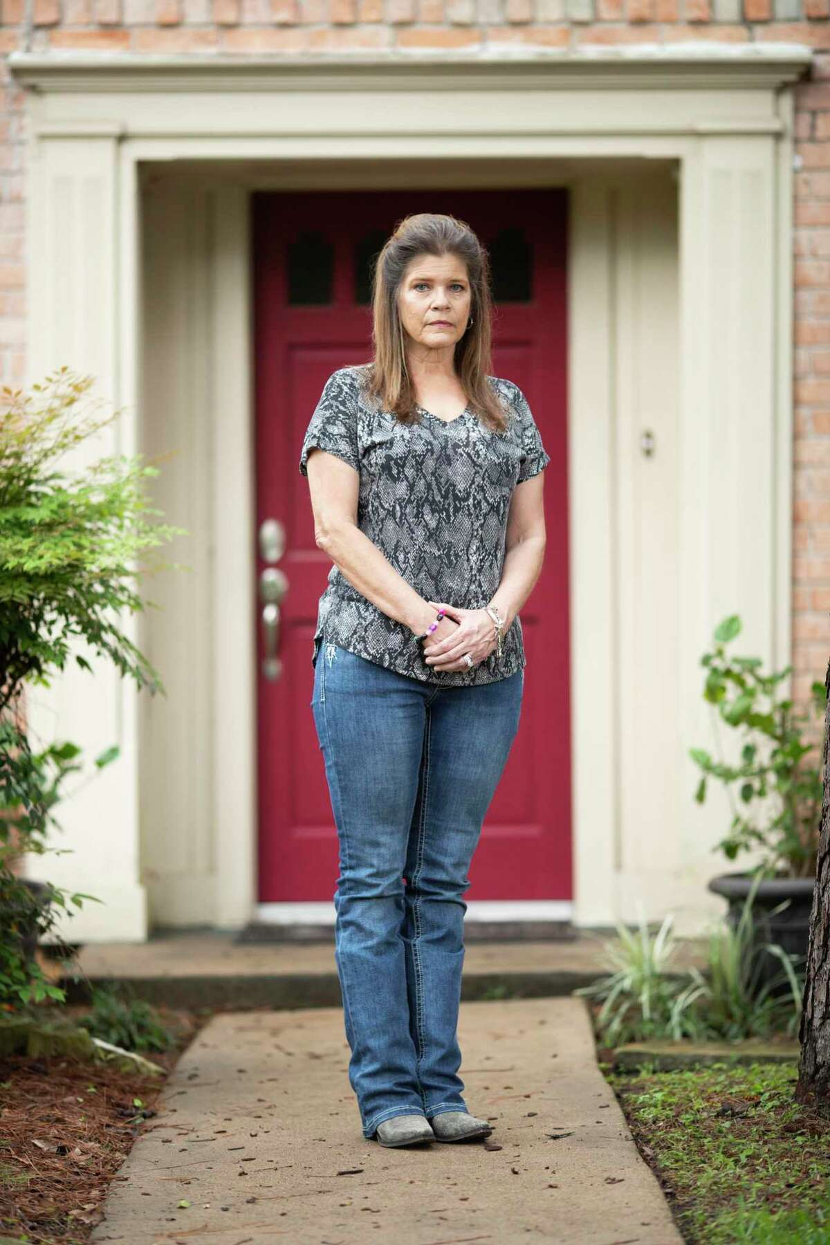 Rynda Scholwinski at her home on Tuesday, April 7, 2020, in Houston. Scholwinski's husband is Raymond, a Harris County Sheriff's Deputy who is in critical condition fighting for his life from COVID-19.