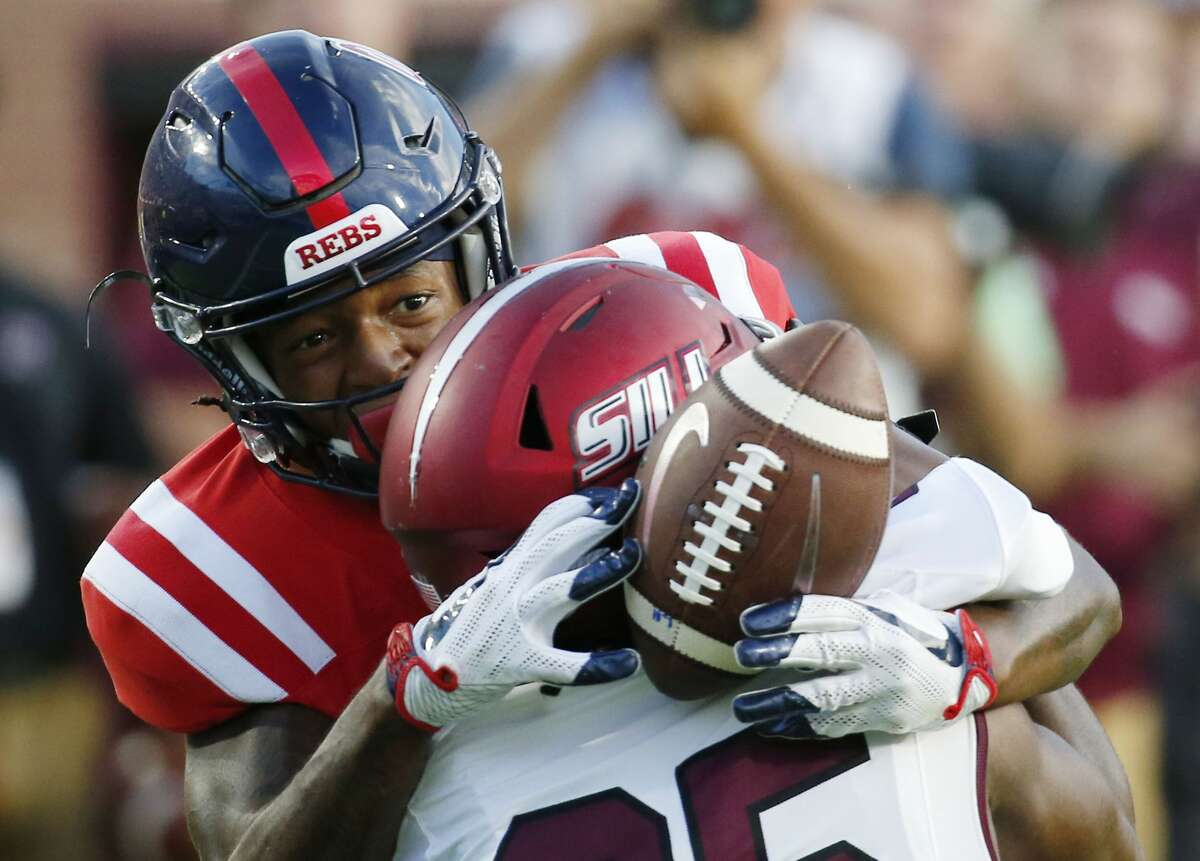 Mississippi wide receiver Alex Weber (85) reaches around Southern Illinois cornerback Madre Harper (25) for a first down pass reception during the second half of their NCAA college football game against Southern Illinois on Saturday, Sept. 8, 2018, in Oxford, Miss. Mississippi won 76-41. (AP Photo/Rogelio V. Solis)