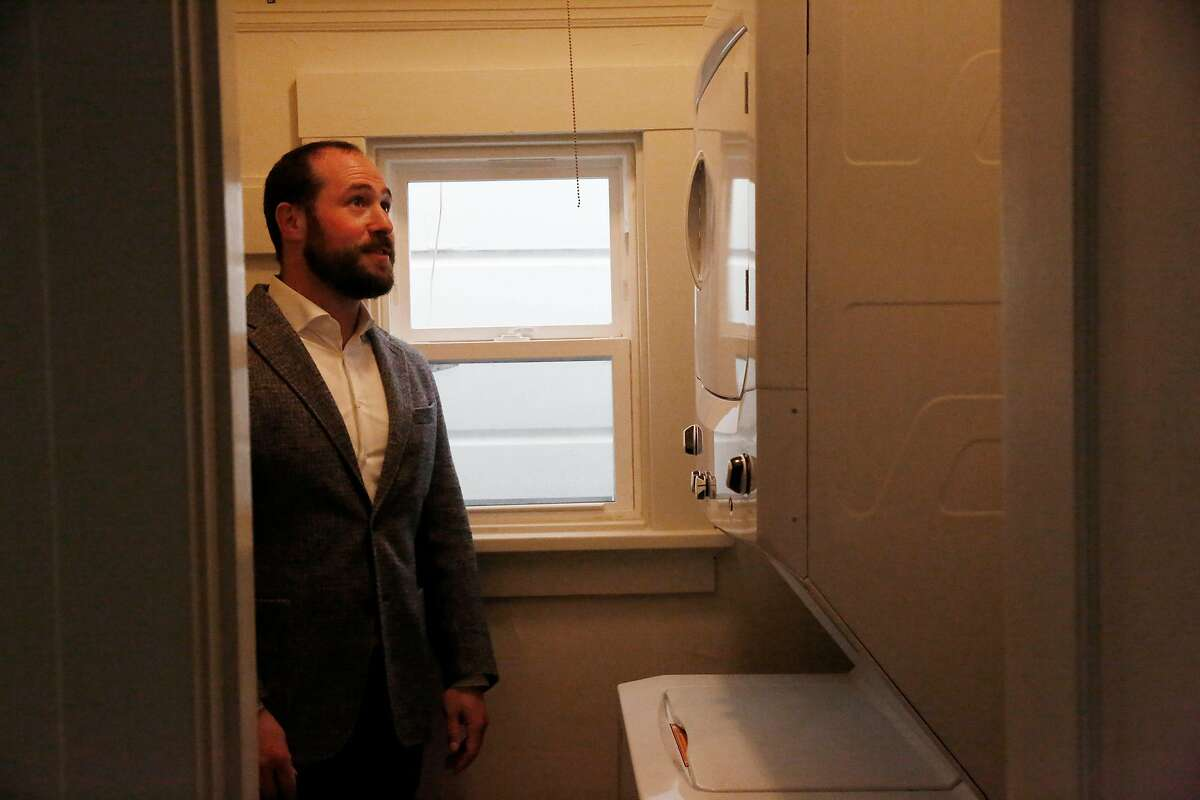 J.J. Panzer, president and broker Real Management Company, looks over a washer and dryer in a vacant unit in an apartment building managed by Real Management Company on Thursday, April 9, 2020 in San Francisco, Calif. Panzer said an in-unit washer and dryer is one of the most requested amenities.