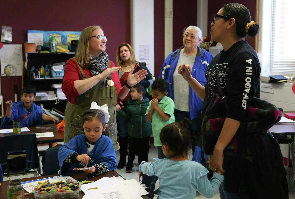 """Hatchett Elementary School art teacher Ann Fletcher, center, talks with students and parents from Pre-K 4 SA during a tour of the school Feb. 26 at a """"Welcome to Kinder"""" event."""