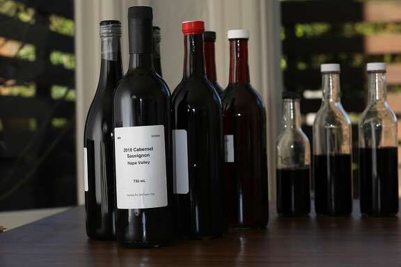 Some of the wine at left bought in bulk from entrepreneur Cameron Hughes which he will use as he launches a new company called De Negoce on Wednesday, March 11, 2020, in San Francisco, Calif.  PHOTOS EMBARGOED UJNTIL FURTHER NOTICE