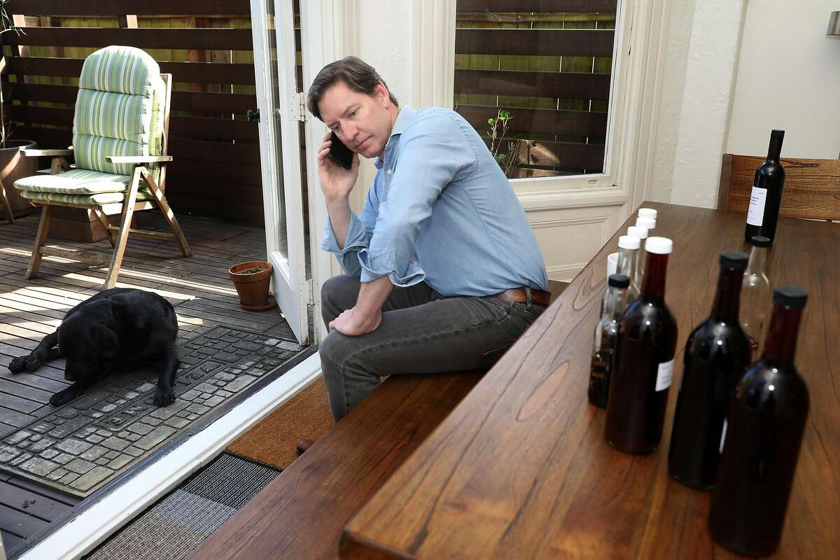 Wine entrepreneur Cameron Hughes (middle) is about to take a conference call while at home with Albert (left) at the dining room table seen on Wednesday, March 11, 2020, in San Francisco, Calif. Cameron is about to launch a new company called De Negoce. PHOTOS EMBARGOED UNTIL FURTHER NOTICE