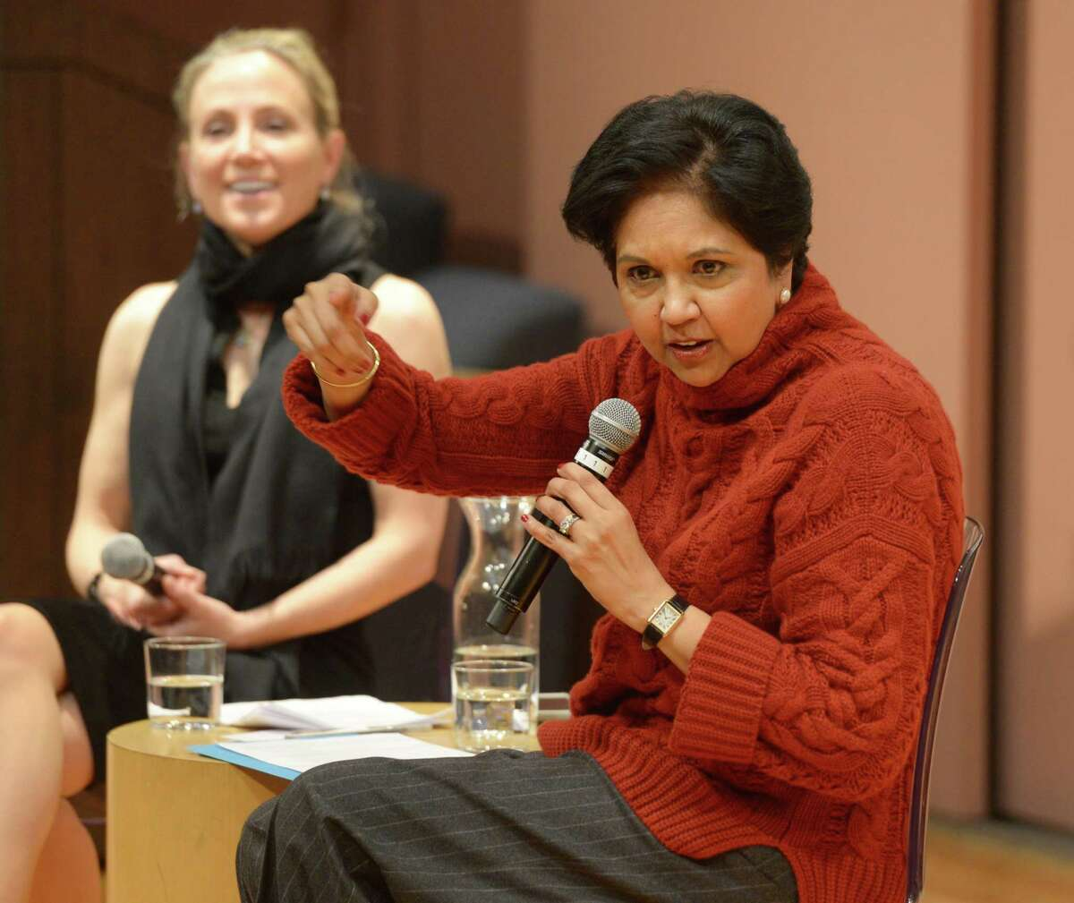 PepsiCo Chairman Indra Nooyi, right, speaks with State Sen. Alex Bergstein, D-Greenwich, during the Community Conversation at Greenwich Library's Cole Auditorium in Greenwich, Conn. Thursday, Jan. 24, 2019. The two discussed how to attract and retain businesses in Connecticut as a small group protested the proposal of tolls outside the event.
