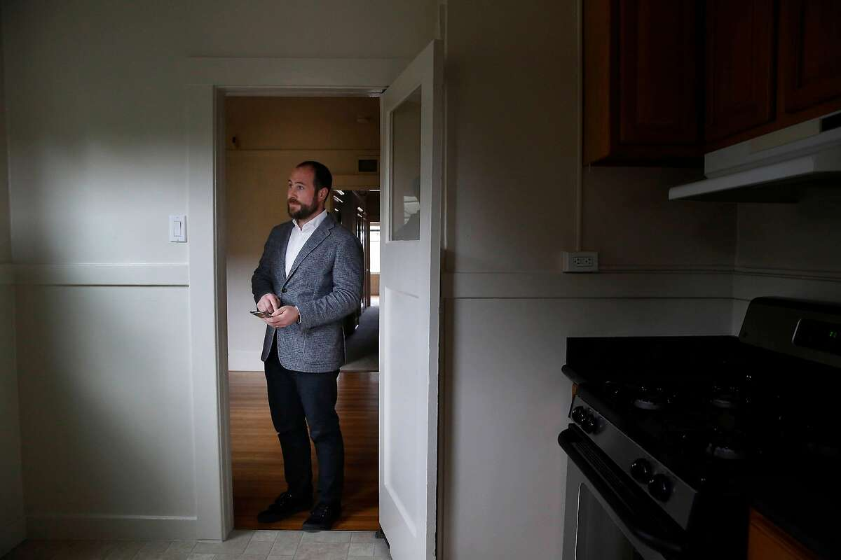 J.J. Panzer, president and broker Real Management Company, stands in the doorway to the kitchen in a vacant unit in an apartment building managed by Real Management Company on Thursday, April 9, 2020 in San Francisco, Calif.