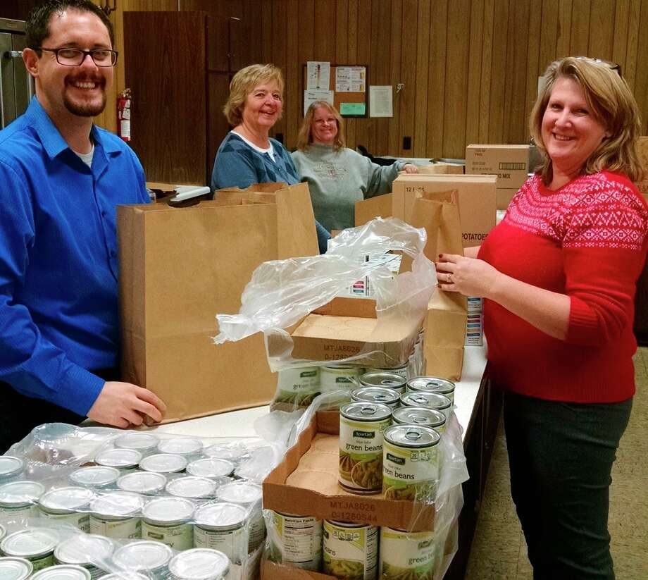 FiveCAP volunteers package donated food for low-income families. (Courtesy photo)
